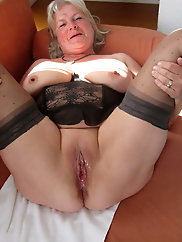 Nasty older bitch is posing seminaked for cash