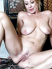 Young-looking aged milf is playing alone